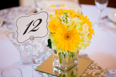 Wedding Table Centerpieces with Flowers. Flowers in glass on the tables for the centerpieces at this indoor wedding reception Stock Image