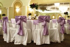 Wedding table and chairs in a banquet ballroom Royalty Free Stock Photos