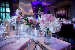 Wedding table for a couple or two. Indoor. Formal, marriage. Wedding table for a couple, two. Indoor. Formal, marriage. Wedding table decorated with bouquet and Royalty Free Stock Photos