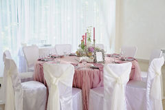 Wedding table decor. Beautiful  set for an event party or  reception. Wedding table decor. Beautiful table set for an event party or wedding reception Chairs Stock Photos