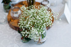 Wedding table decor. Wedding centerpiece with babies breadth flowers Royalty Free Stock Photography