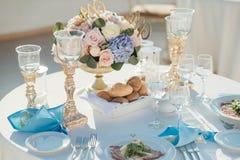 Wedding table decor in gold color. On the island of Santorini Stock Photos