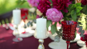 Wedding table decor at the nature with  candles stock footage