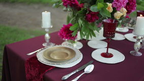 Wedding table decor at the nature with lighted candles, close-up. stock video footage