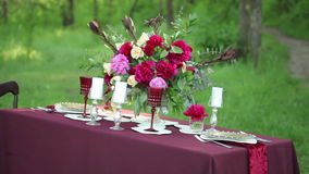 Wedding table decor at nature on a sunny day. Steadicam shot stock footage