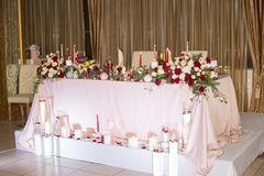 Wedding table decor with red flowers and candles stock photos