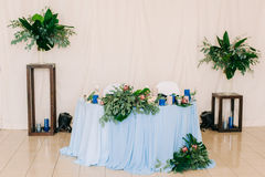 Wedding table decorated with bouquet and candles Stock Images