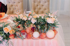 Wedding table decorated with bouquet and settings Royalty Free Stock Photography