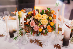 Wedding table that decorated. With flower arrangements and candles Stock Images
