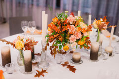 Wedding table that decorated. With flower arrangements and candles Stock Photography