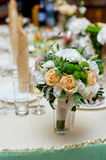 Wedding table decorated with flowers and serving in the restaurant Stock Images