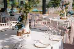Wedding table decoration with candles and bouquets Stock Image