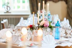Wedding table decoration with candles and flowers stock image