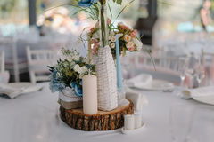 Wedding table decoration with candles and rose bouquet Stock Image