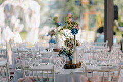Wedding table decoration with candles and rose bouquets Stock Photos