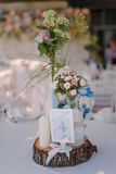 Wedding table decoration with candles and rose bouquetsWedding table decoration with candles and rose bouquets Royalty Free Stock Photography
