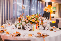 Wedding table decoration. Table decor with flowers table numbers and candles Royalty Free Stock Images