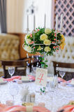 Wedding table decoration and floral centerpiece Royalty Free Stock Images