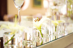 Wedding table decoration. With flowers, candle and glassware Royalty Free Stock Photo