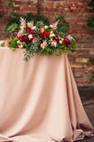 Wedding table decoration. Flowers composition with roses Stock Image
