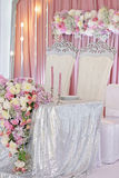 Wedding table decoration with flowers and eclectic chandeliers. Pregnancy, motherhood, people and expectation concept - happy pregnant woman a walk in the park Stock Images