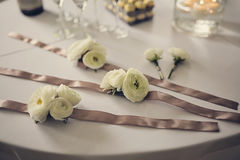 Wedding table decoration. Flowers with ribbons on a wedding table Royalty Free Stock Photography