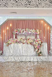 Wedding table decoration with flowers tulle and eclectic chandeliers. Wedding table background color roses peonies pink white hydrangea Coral table and chairs Royalty Free Stock Photography