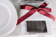 Wedding table decoration of the napkin with the vinous ribon Stock Image