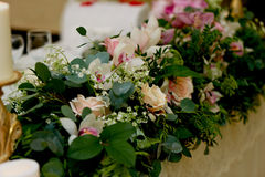 Wedding table decoration newlyweds. Songs on the table of flowers. The pink and white palette, rose, Orchid Stock Image