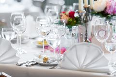 Wedding table decoration in restaurant stock photos