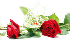 Wedding table decoration rose. Photo shows a nice red rose on a wedding decorated table with a glass of sparkling wine and some small hearts - roses Royalty Free Stock Photo