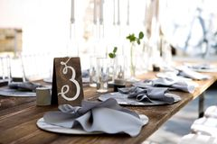 Wedding table decoration. Wedding tablets on the table. Table number three. Wedding textiles on the table stock photo