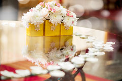 Wedding Table Decoration. With white petals and flowers. Selective focus Stock Photos