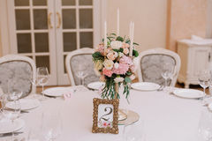 Wedding table decoration with the white and pink roses, carnations and candles royalty free stock photos