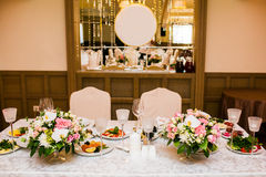 Wedding table decorations on banquet with flowers Royalty Free Stock Images