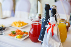 Wedding table with dishes and bottles. Bottle the bride and groom. Table linens for Banquet and party. Wedding, Banquet indoors Royalty Free Stock Image
