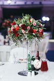 Wedding table with drinks decorated with bouquet of roses and gr Royalty Free Stock Photography