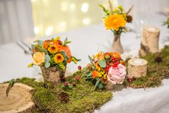 Wedding table with floral arrangement prepared for reception, wedding, birthday or event centerpiece.  stock image