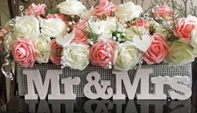 Wedding table floral oasis covered in glitter with mr & mrs