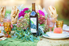 Wedding table with florals and wine Stock Photos