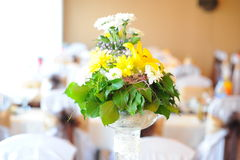Wedding table flower bouquet. Flower bouchet wedding table with yellow and white royalty free stock images