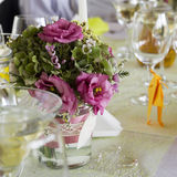 Wedding table. Wedding  flower  bouquet on a table in a luxury restaurant Royalty Free Stock Images