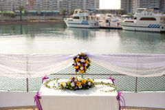 Wedding table flower settings in yacht. Wedding ceremony table flowers in yacht settings Royalty Free Stock Photography