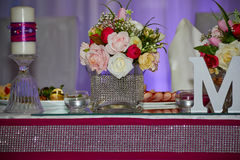 Wedding table with flowers. And candles Stock Photo