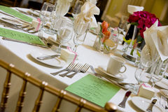 Wedding table with green menu. A wedding table with green menus set for dinner Stock Photos