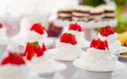 Wedding Table with Mini Cakes with Strawberry on the Top. Wedding Table with Mini Cakes with Strawberry Royalty Free Stock Photos