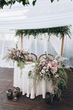 Boho wedding table for a newlywed banquet. Wedding table for a newlywed banquet with eco decor and floral design in the style of boho stock photo