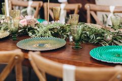 Boho wedding table for a newlywed banquet. Wedding table for a newlywed banquet with eco decor and floral design in the style of boho royalty free stock images