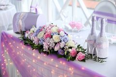 Wedding table for newlyweds with flowers Royalty Free Stock Image