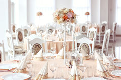 Wedding table with ornaments. And dishes on Royalty Free Stock Images